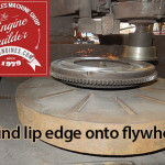 Grind lip angle edge onto flywheel